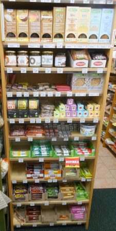 Shelf of raw food products in Czech organic shop